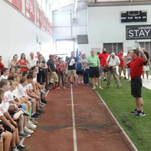 giving a speech at the Just for Kids Football Clinic