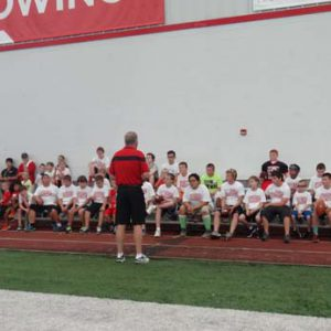 Bobby Petrino speaking at the Just for Kids Football Clinic