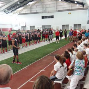 Louisville football players speaking at the Just for Kids Football Clinic