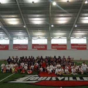 A group photo at the Just for Kids Football Clinic