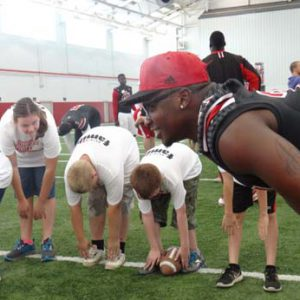 stretching at the Just for Kids Football Clinic