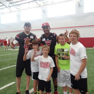 Football players at the Just for Kids Football Clinic