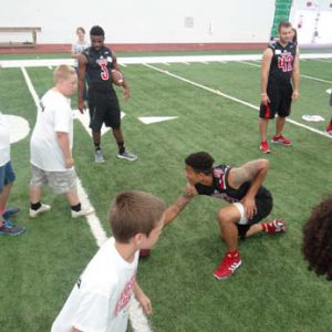 University of Louisville Football players at the Just for Kids Football Clinic
