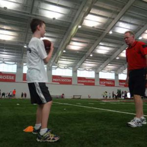 Bobby Petrino coaching at the Just for Kids Football Clinic
