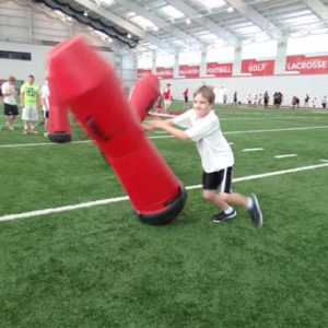 making a tackle at the Just for Kids Football Clinic