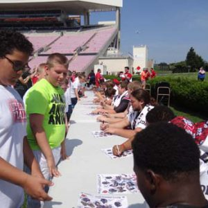 University of Louisville Football players signing autographs